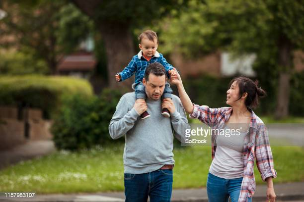 having fun outdoors with mum and dad - mid adult stock pictures, royalty-free photos & images