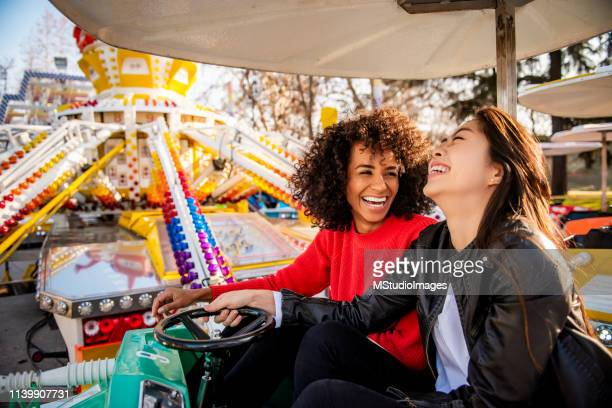 having fun. - traveling carnival stock pictures, royalty-free photos & images