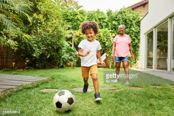 having fun playing football with grandma - brazil stock pictures, royalty-free photos & images