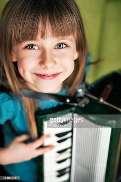 Having fun playing the accordion