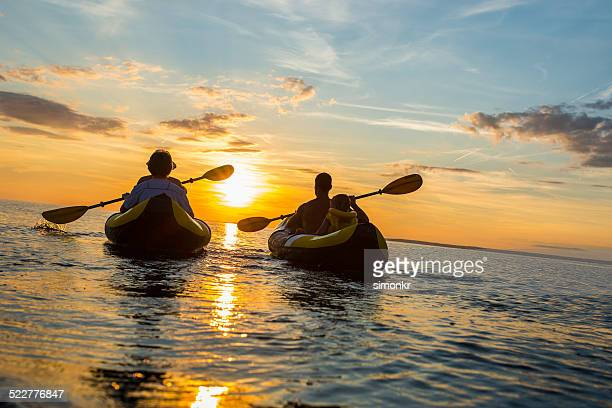 Having Fun Sea Kayaking At Sunset