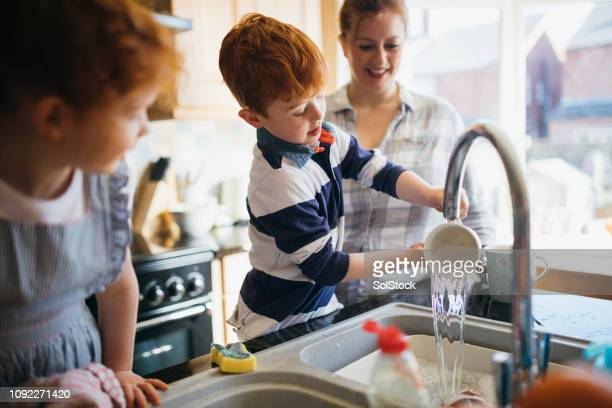 having fun washing the dishes - one parent stock pictures, royalty-free photos & images