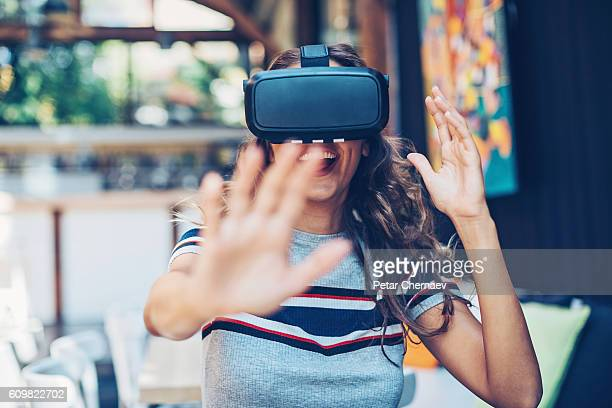 having fun with a virtual reality headset - stereoscopic images stock photos and pictures