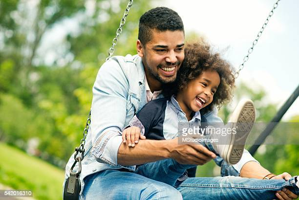 having fun with daughter. - swinging stock pictures, royalty-free photos & images
