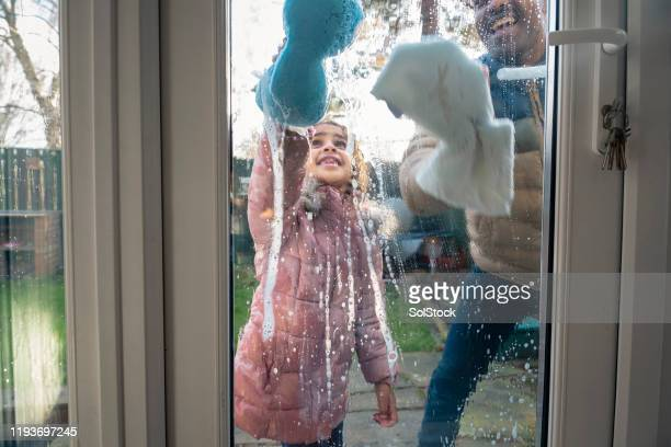 having fun with soap suds - green coat stock pictures, royalty-free photos & images