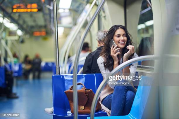 having great conversations on the cell while on the commute - underground stock photos and pictures