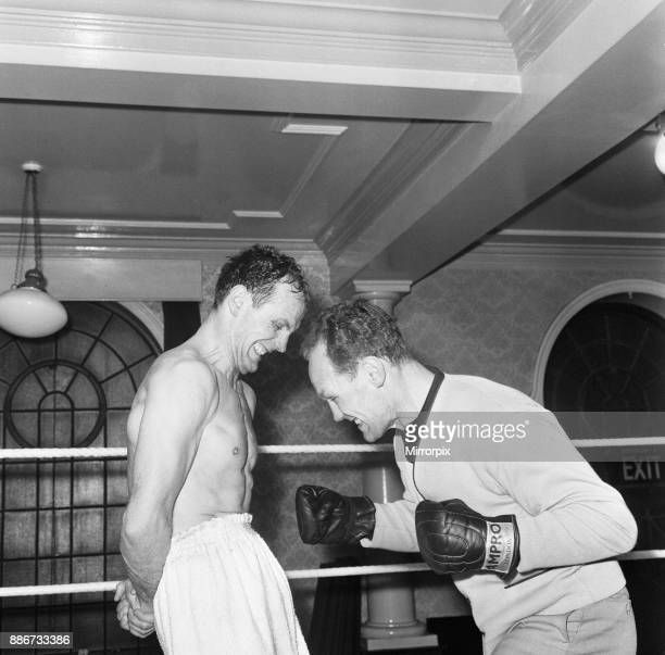 Having his stomach muscles strengthened is British Heavyweight Champion Henry Cooper who defends his title against Dick Richardson at Wembley Helping...