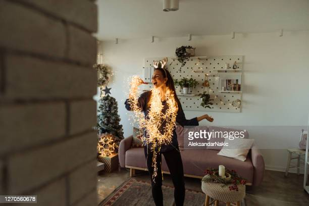 having my solo concert in the living room - christmas music stock pictures, royalty-free photos & images