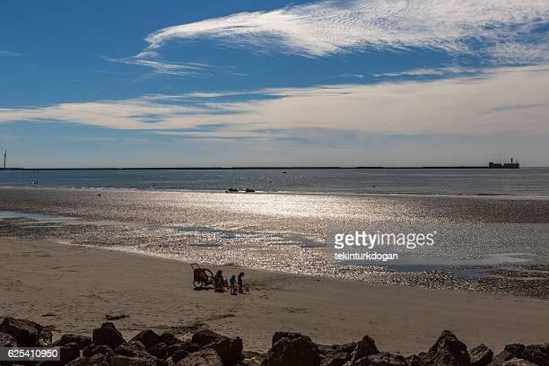 having picnic at sandy normandy during tide near calais france