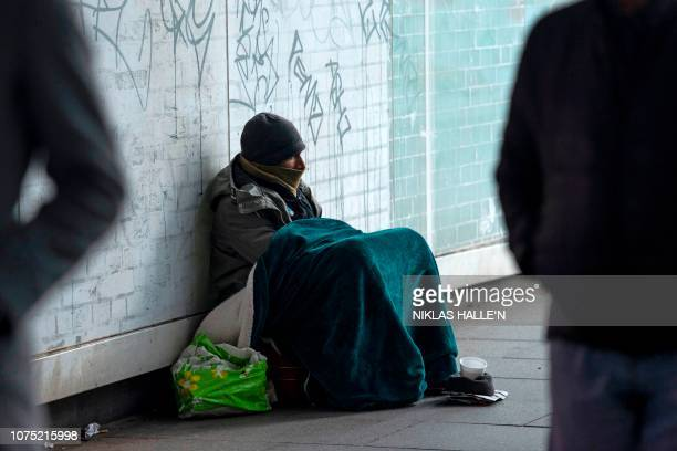Having previously worked in his family's minicab business Abdul aged 40 from London sits in an underpass near to Waterloo Station on December 27...