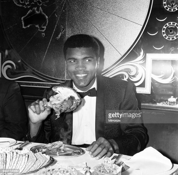 Having retained his world heavyweight crown against British Challenger Henry Cooper World Champion Muhammad Ali tucks into a chicken at Isows...