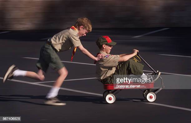 Having some fun on a Saturday morning Boy Scouts Kyle Schleiderer and Jonathan Barnes of Troop 103 in Ventura ride a wagon that later in the...