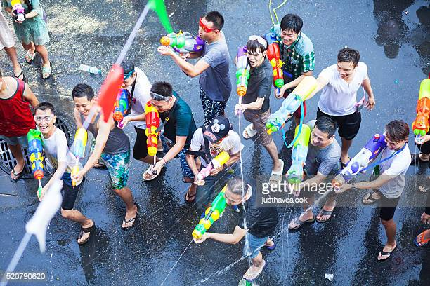 Having Songkran water fight