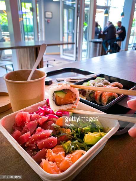 having sushi for lunch, copenhagen, denmark - vsojoy stock pictures, royalty-free photos & images