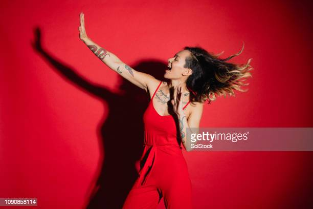 having the time of her life - red background stock pictures, royalty-free photos & images