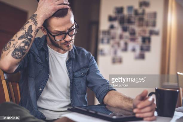 having trouble while working - tattoo stock pictures, royalty-free photos & images