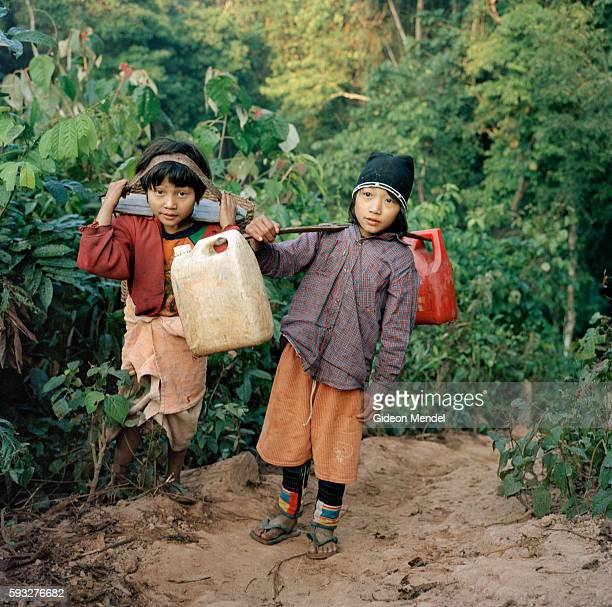 Haw Lo and DzonYeu collect water at the end of the day They live in the Ban Nam Lai Akha village The Akha are a hill tribe of subsistence farmers...