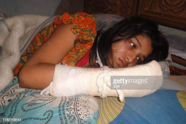 Hawa Akhter is seen in a hospital in Dhaka on 15 December 2011 Bangladesh police said December 15 they would press charges against a migrant worker...