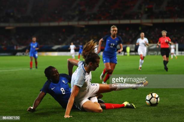 Hawa Cissoko of France tackles Jill Scott of England during the International friendly match between France and England held at Stade du Hainaut on...