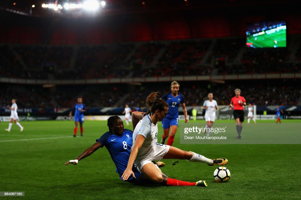 Hawa Cissoko of France tackles Jill Scott of England during the International friendly match between France and England held at Stade du Hainaut on October 20, 2017 in Valenciennes, France.
