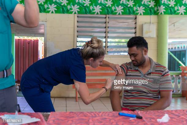 Hawaii aid workers help out with MMR vaccinations on December 6, 2019 in Apia, Samoa. Samoan officials report over 90% of eligible Samoans have been...