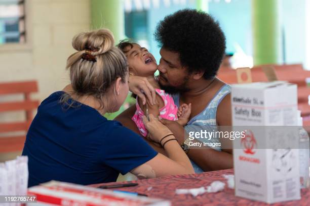 Hawaii aid workers help out with MMR vaccinations on December 6 2019 in Apia Samoa Samoan officials report over 90% of eligible Samoans have been...