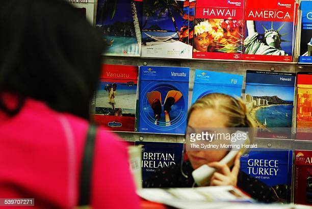 Hawaii and America brochures advertise at a Flight Centre travel agency in Sydney 16 January 2004 SMH Picture by BRENDAN ESPOSITO