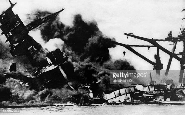 USA Hawaii Attack on Pearl Harbor by the Imperial Japanese Navy on December 7 1941 Sinking of the battleship 'Arizona' causing a huge cloud of smoke...