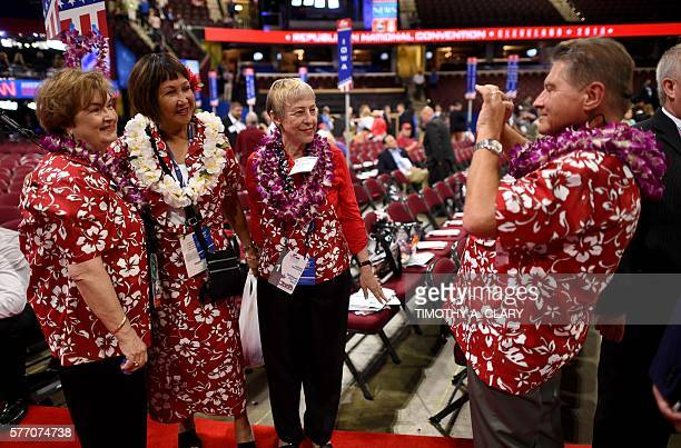 Hawaii delegates gather on the first day of the Republican National Convention on July 18 2016 at the Quicken Loans Arena in Cleveland Ohio The...