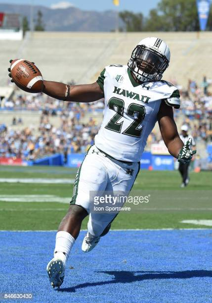 Hawai'i Diocemy Saint Juste celebrates after scoring a touchdown during a college football game between the Hawai'i Rainbow Warriors and the UCLA...