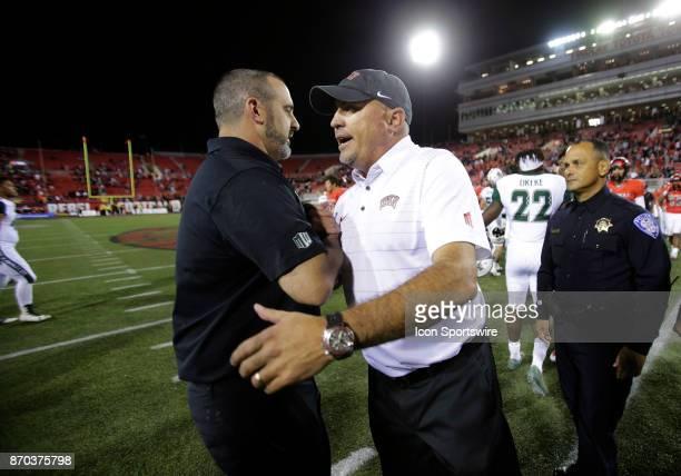 Hawaii head coach Nick Rolovich and UNLV head coach Tony Sanchez meet midfield following a game on November 04 at Sam Boyd Stadium in Las Vegas...
