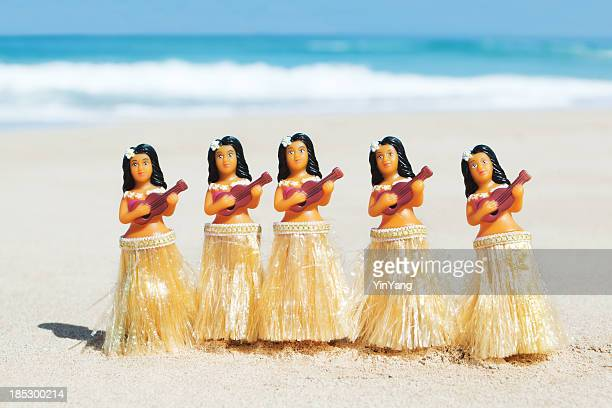 hawaii hula dancers figurine dolls dancing on beach, strumming ukuleles - hula dancer stock pictures, royalty-free photos & images