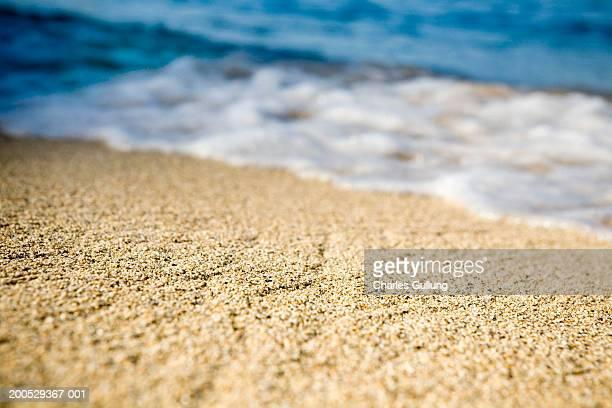 USA, Hawaii, Kauai, North Shore, surf and sand (focus on sand)