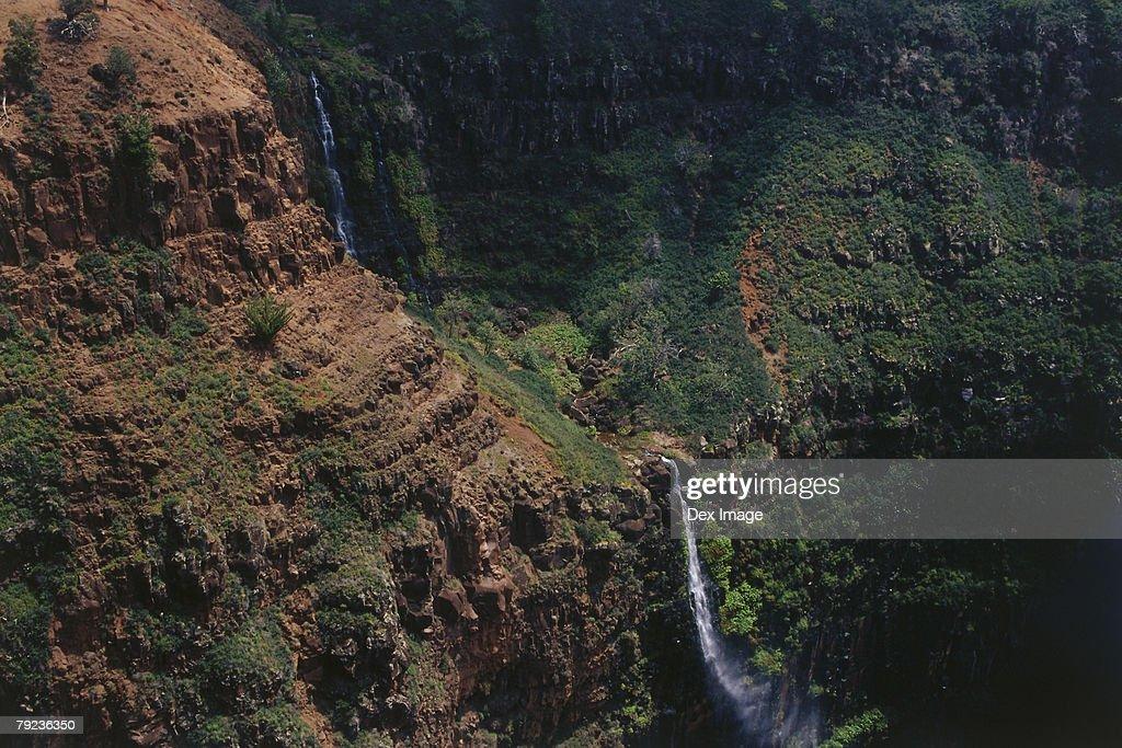 USA, Hawaii, Kauai, Waterfall and mountain range : Stock Photo