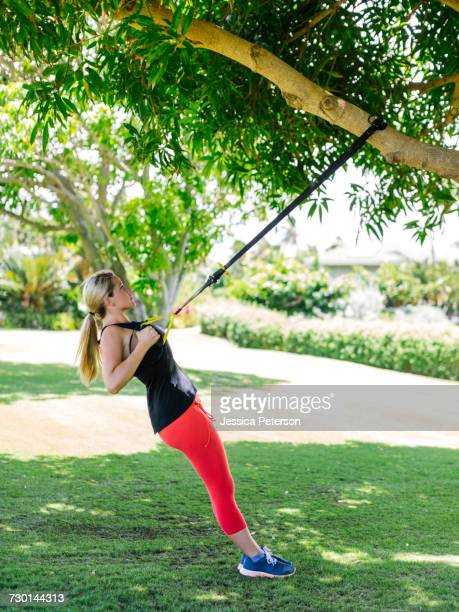 usa, hawaii, kauai, woman doing trx training - category:census-designated_places_in_honolulu_county,_hawaii stock pictures, royalty-free photos & images