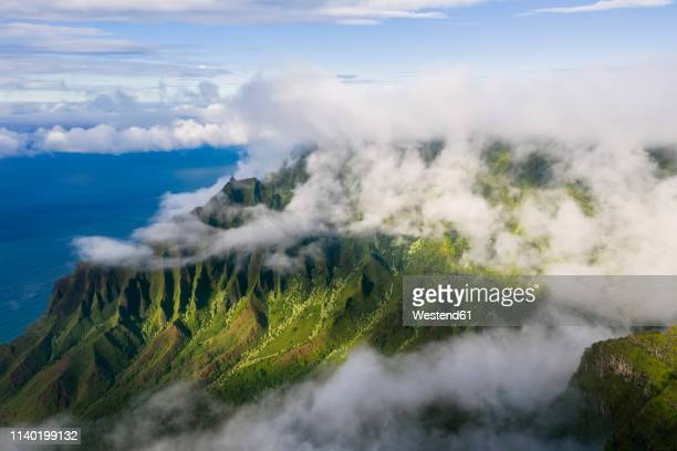 usa, hawaii, koke'e state park, view to kalalau valley and clouds - hawaii islands stock pictures, royalty-free photos & images