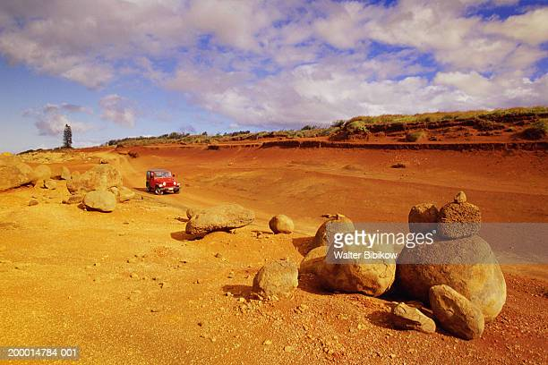 USA , Hawaii, Lanai, Garden of the Gods, Red dirt road and 4x4