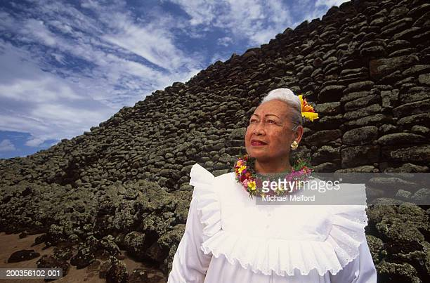 usa, hawaii, mature woman at mo'okini heiau - lei day hawaii stock pictures, royalty-free photos & images