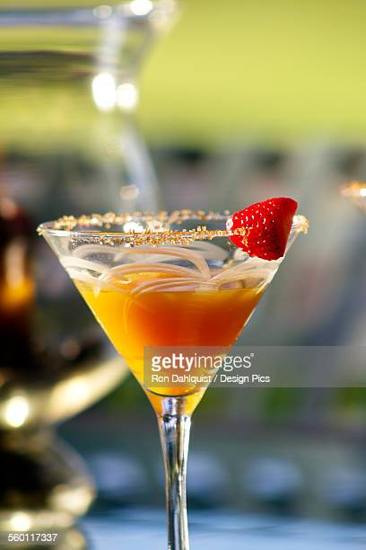 hawaii, maui, a tropical mango martini with strawberry garnish. - media_in_honolulu,_hawaii stock pictures, royalty-free photos & images