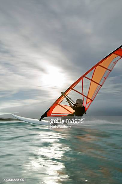 usa, hawaii, maui, mature man windsurfing (blurred motion) - windsurfing stock pictures, royalty-free photos & images