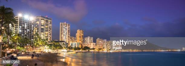 usa, hawaii, oahu, waikiki beach panorama at night - waikiki stock pictures, royalty-free photos & images