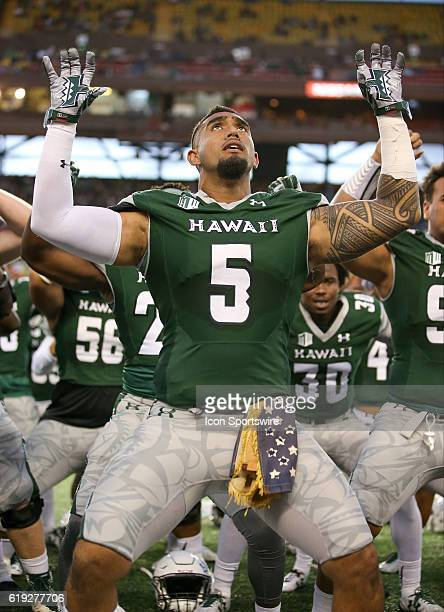 Hawai'I Rainbow Warriors defensive lineman Makani KemaKaleiwahea does the Haa while wearing a 50 year old US flag given to him by a Vietnam veteran...