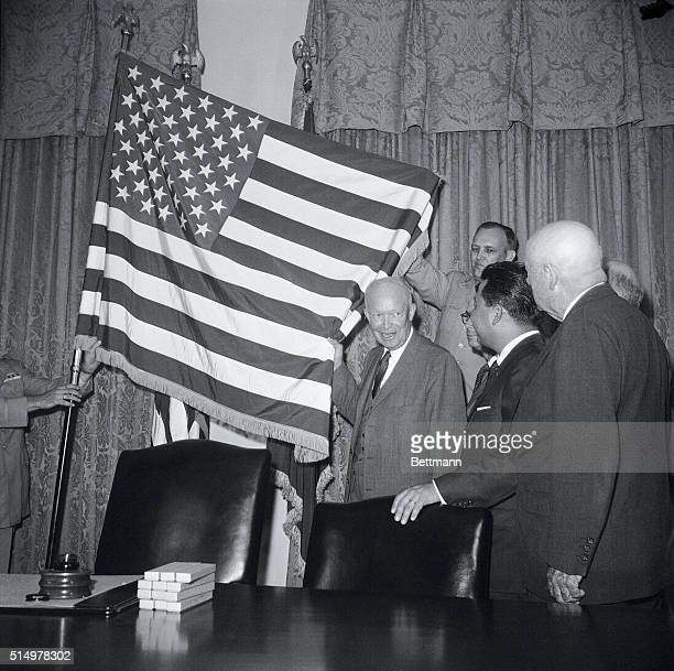 Hawaii Signed into the Union. Washington: The new 50-star flag in unfurled at the White House today after President Eisenhower signed a proclamation...