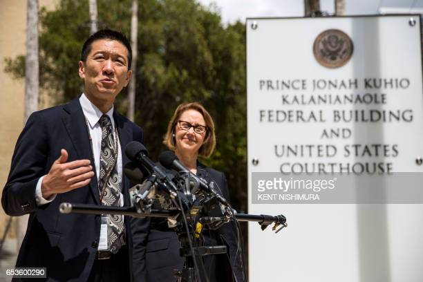 Hawaii State Attorney General Douglas Chin speaks as Oregon Attorney General Ellen Rosenblum looks on at a press conference in front of the Prince...