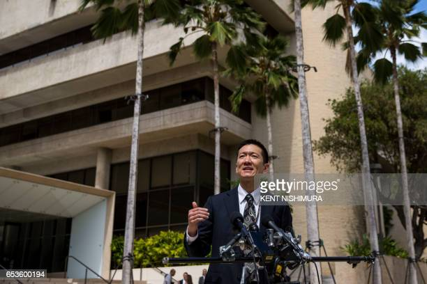 Hawaii State Attorney General Douglas Chin speaks at a press conference in front of the Prince Jonah Kuhio Federal Building and US District...