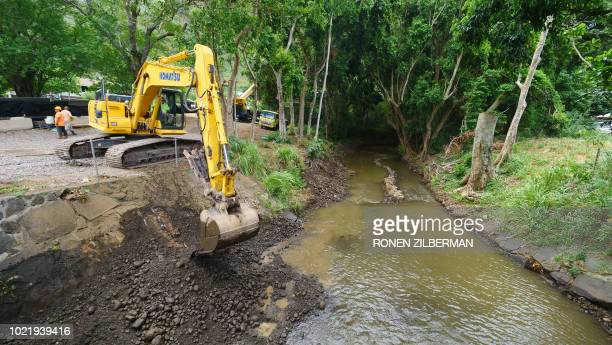 Hawaii state workers clean debris and open up streams around Honolulu in preparation for heavy rainfall and flash flooding expected from Hurricane...