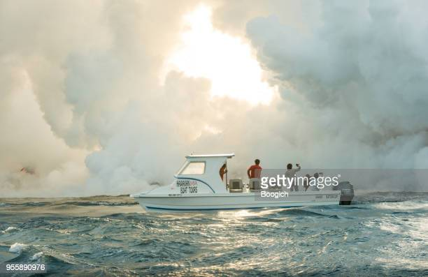 hawaii tour boat brings people to see volcanic landscape - hawaii volcanoes national park stock pictures, royalty-free photos & images