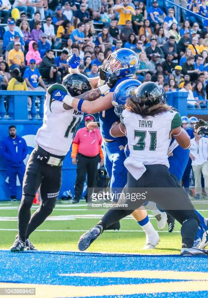 Hawaii Warriors defensive back Manu HudsonRasmussen and Hawaii Warriors linebacker Jahlani Tavai make a goal line stand during the game between the...