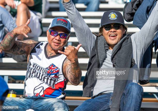 Hawaii Warriors fans celebrate a Warriors touchdown during the game between the Hawaii Warriors and the San Jose State Spartans on Saturday September...