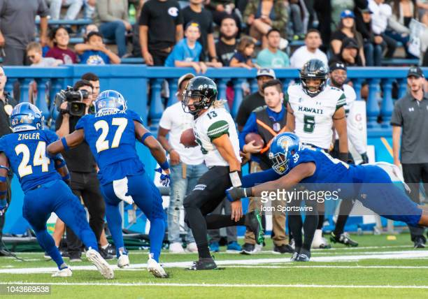 Hawaii Warriors quarterback Cole McDonald opts to run for a play during the game between the Hawaii Warriors and the San Jose State Spartans on...
